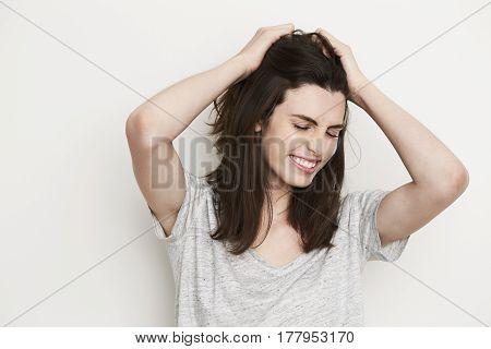 Cute Frustrated brunette in studio eyes closed