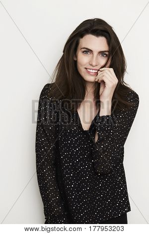 Gorgeous brunette in black fashion portrait studio