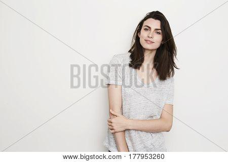 Cute Grey t-shirt brunette smiling at camera