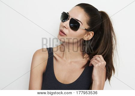 Cool Cute Brunette with shades in studio