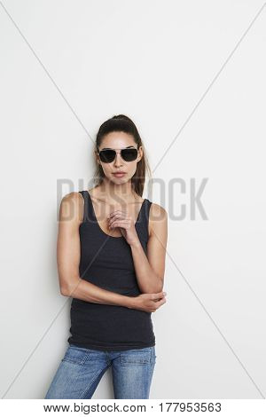 Cool woman in vest and shades portrait