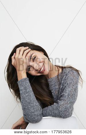 Cute Smiling brunette woman in grey portrait