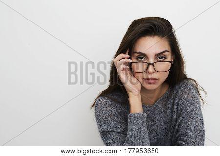 Brunette babe with glasses portrait studio shot