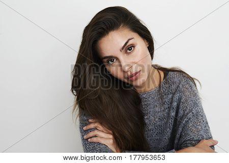 Brunette with brown eyes in studio portrait