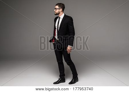 Full Length Of Confident Young Businessmen In Sunglasses Standing Isolated On Grey