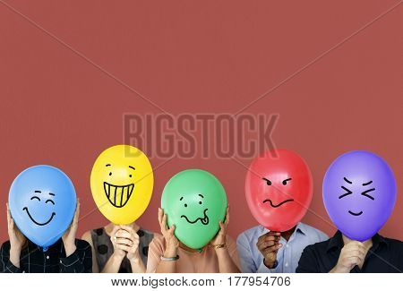Group of people holding balloon express their emotion