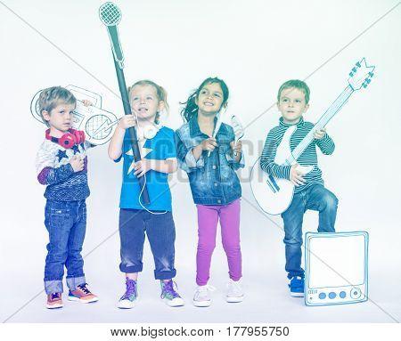Kids music band playing and listening music having fun