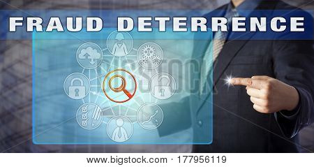 Male enterprise auditor in blue shirt and suit is advising on FRAUD DETERRENCE. Information technology metaphor and business concept for preventive measures in auditing and process management.