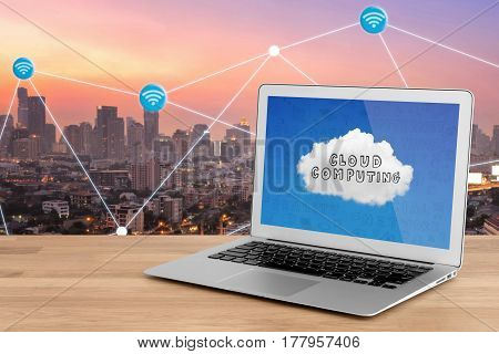 Smart Modern Laptop Showing Technology For Cloud Computing On Screen With Smart City With Wifi Conne