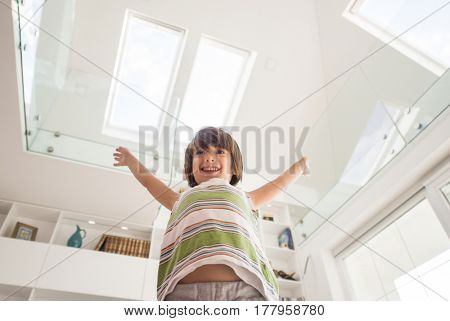 Excited cute child at new house indoors