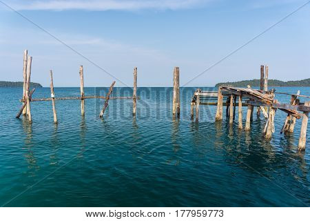 Old Wooden Post Of A Collapsed Jetty