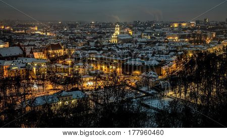 Aerial panorama of the Vilnius Old Town at dusk time. Night panorama of the Vilnius Old Town from the Hill of Three Crosses Lithuania. Vilnius winter aerial panorama of Old town.
