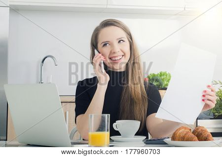 Young Woman Talking On The Phone, Working In Home