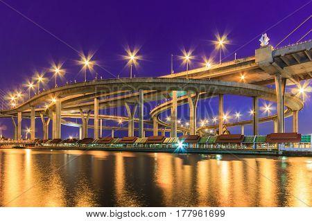 Night cityscape of Bhumibol Bridge (named from King Bhumibol of Thailand) across Chao Phraya River Bangkok city skyline Thailand