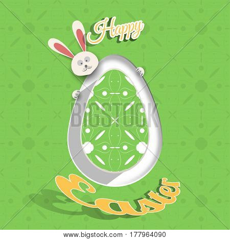 Greeting poster for Happy Easter holiday with green egg cut from paper peeping rabbit shadow geometric pattern and text on the green background with pattern.
