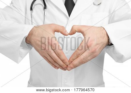 Hands of young doctor forming heart, closeup. Cardiology concept