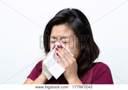 Young Chinese Woman Blowing Her Nose