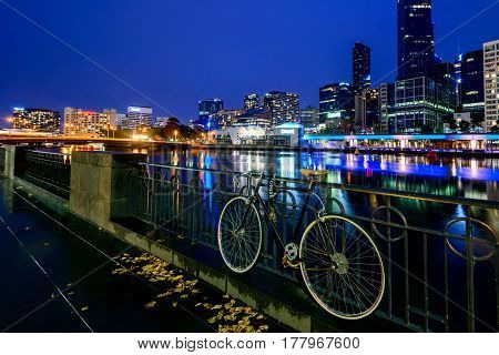 Melbourne Australia - December 27 2016: Vintage style bicycle parked in Melbourne CBD near the Yarra river at night