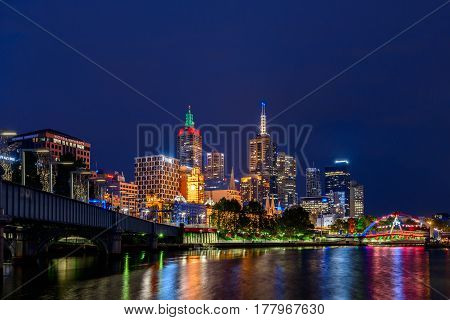 Melbourne Australia - December 27 2016: Melbourne city illuminated skyscrapers at night viewed across the Yarra river