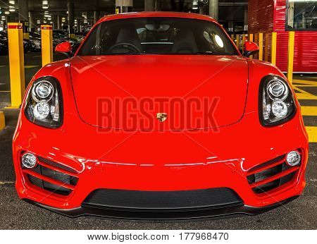 Sydney, Australia - January 21, 2015: Front view of a red turbo sport car Ferrari F40 in the airport parking lot. Concept of luxory and speed.