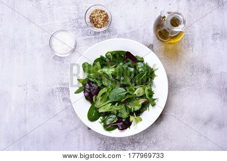 Green salad with leaves of spinach arugul. Healthy food top view