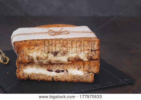 Rustic homemade grilled sandwiches on dark  surface. Macro, selective focus, blank space