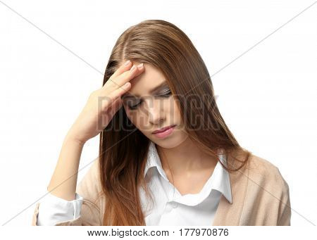 Beautiful young woman suffering from headache on white background
