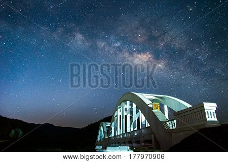 Milky way and white bridge in Lamphunnorth Thailand.