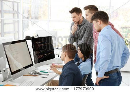 Young programmers working in office