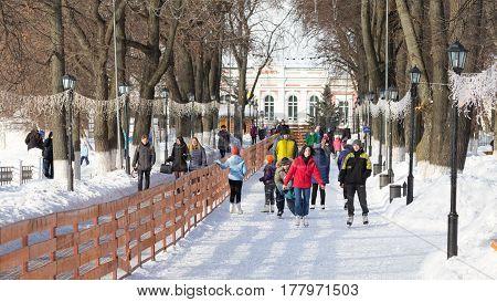 Vladimir -12 February 2017: Happy people skate on a beautiful city skating rink on a winter day February 12 2017Vladimir Vladimir region Russia