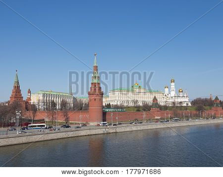 April 12 2015: Beautiful buildings of the Moscow Kremlin the Moscow River and automobile traffic along the Kremlin embankment April 12 2015 Moscow Russia