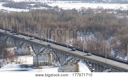 Vladimir -12 February 2017: The Big Bridge across the Volga River and the Cars Go Winter February 12 2017 Vladimir Vladimir Region Russia