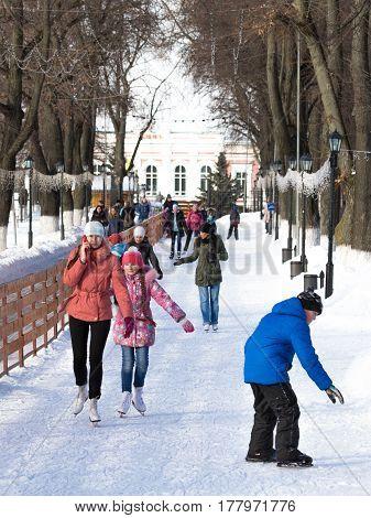 Vladimir -12 February 2017: Happy people skate on a beautiful city ice rink in the winter February 12 2017Vladimir Vladimir region Russia
