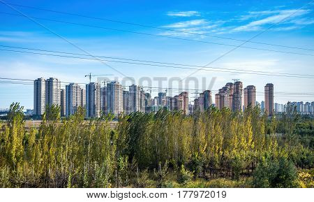 Beijing, China - Oct 31, 2016: High-rise apartments being built. Scene captured from within a High-Speed Rail (HSR) bullet train traveling at 300 km/h.