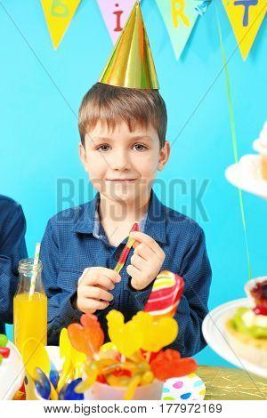 Cute little boy celebrating birthday at home