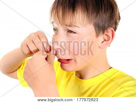 Sad Kid with Pimple Isolated on the White Background