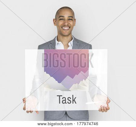 Businessman holding placard task graphic