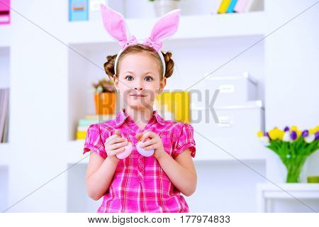 Easter holiday. Cute happy girl preparing for the celebration of Easter.