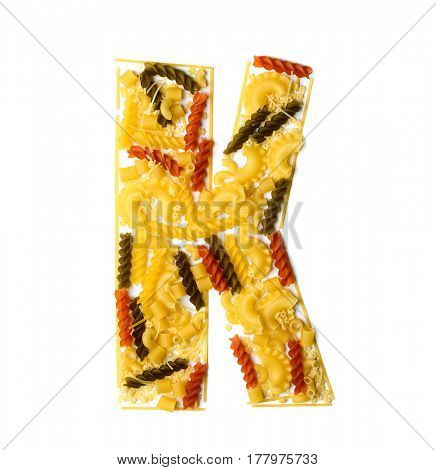 Pile of spaghetti forming a letter K, all different shapes, colors and varieties