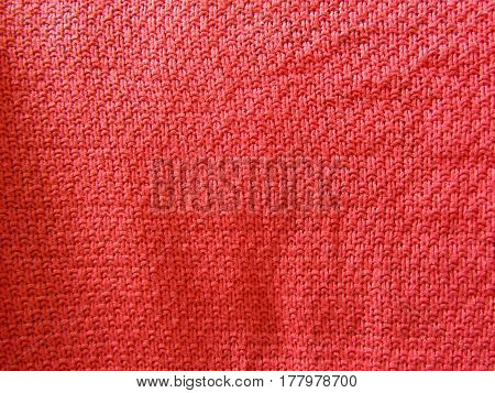 Knitted fabric pink color the texture of crumpled tissue