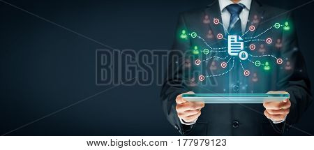 Corporate data management system (DMS) and document management system with privacy theme concept. Businessman or programmer with tablet and scheme with protected document connected with users access rights symbolized by key.