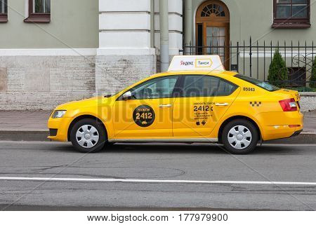 ST. PETERSBURG RUSSIA - JULY 29 2016: Yandex taxi at the city street in St. Petersburg Russia