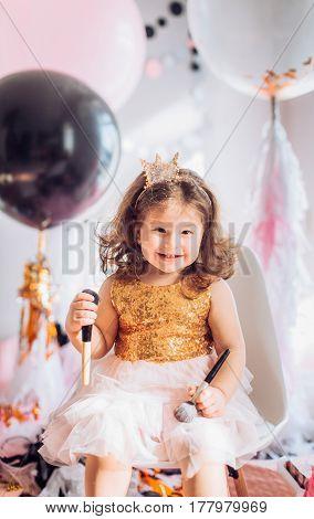 Beautiful little girl celebrating birthday party. Family celebration of the child