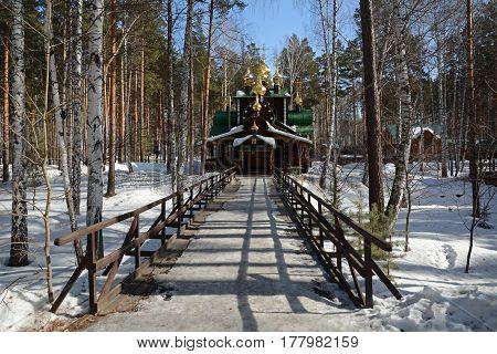 Wooden Russian Orthodox Christian Church of St. Nicholas in Ganina Yama Monastery on early Spring, Ekaterinburg, Russia.