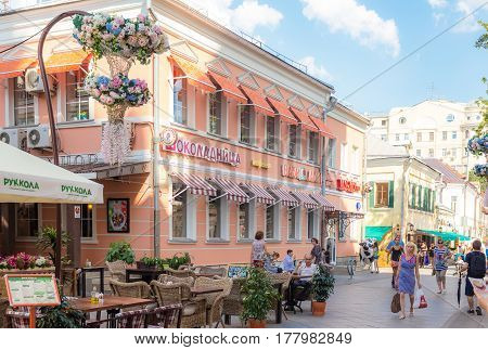 MOSCOW - AUGUST 7 2016: Opened terrace of cafe on Klimentovsky lane on clear day. This area was reconstructed and became pedestrian in 2014.