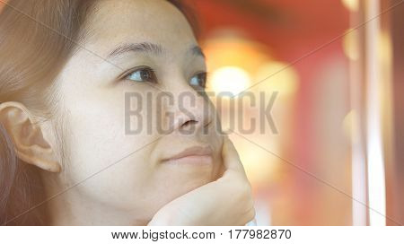 Mixed Race Asian Woman Looking Away, Thinking And Smiling