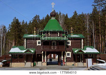 Wooden Russian Orthodox Christian Gate Church in Ganina Yama Monastery on early Spring, Ekaterinburg, Russia.