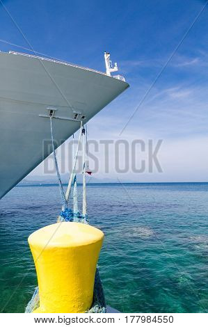 A Cruise Ship Tied to Yellow Bollard