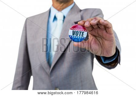 Businessman holding a badge on white background