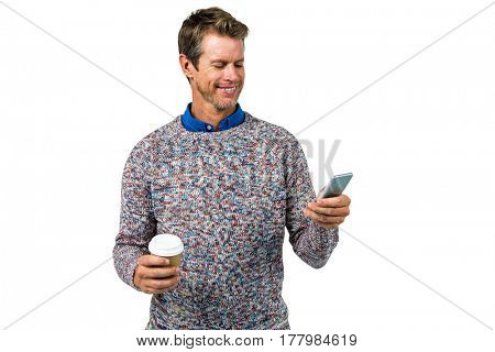 Smiling man using mobile phone against white background